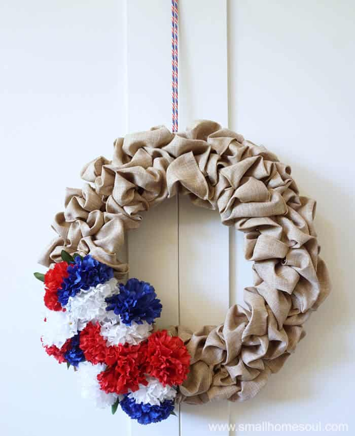 A shoestring hangs the July 4th Wreath from the door for 4th of July.