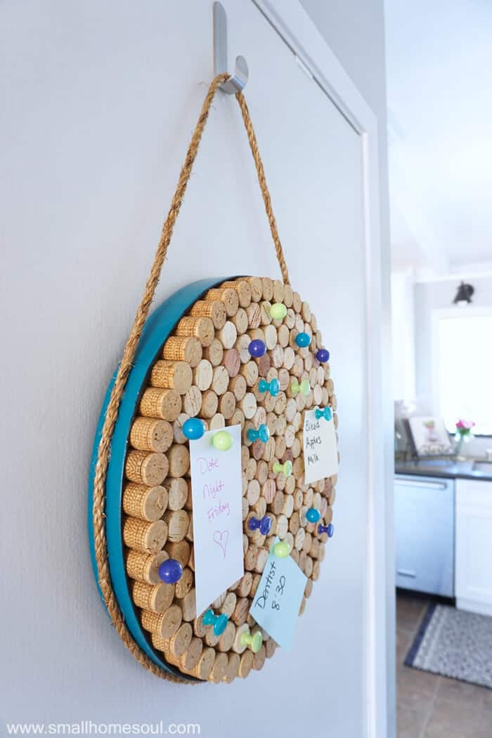 DIY Wine Cork Board hung in kitchen entry.