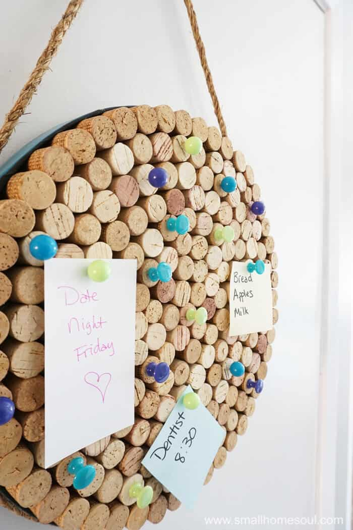 Closeup details of DIY wine cork board in use.