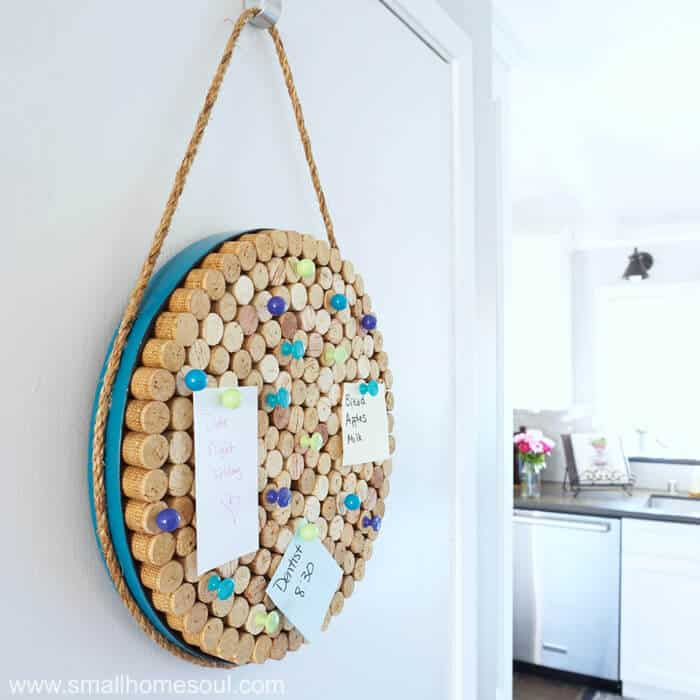 Completed wine cork board hanging on utility door.
