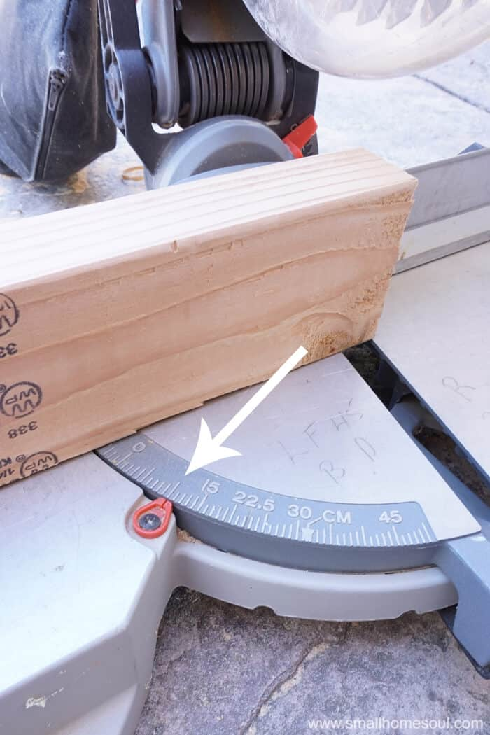 Miter saw base showing 10 degree bevel cut on 2x4
