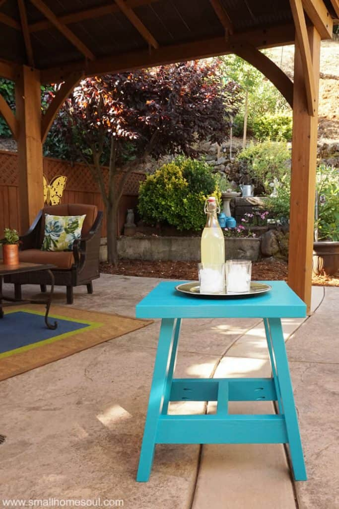 This 2x4 Outdoor Table is ready to serve refreshments to guests on the patio.