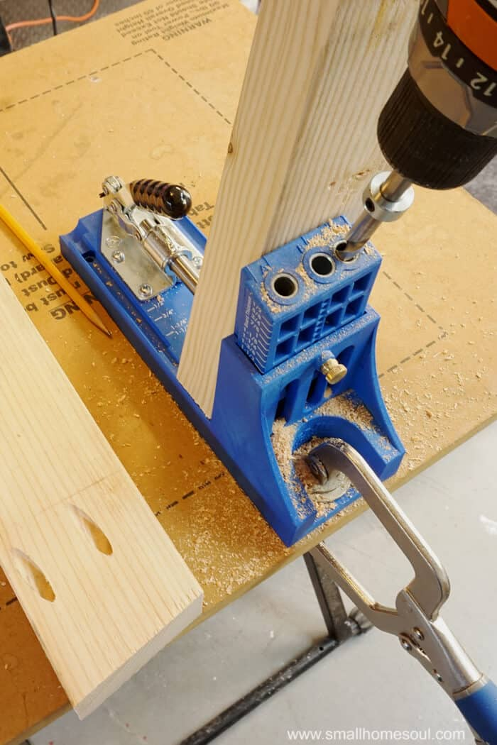 Kreg Pocket Hole Jig clamped to work table and cordless drill