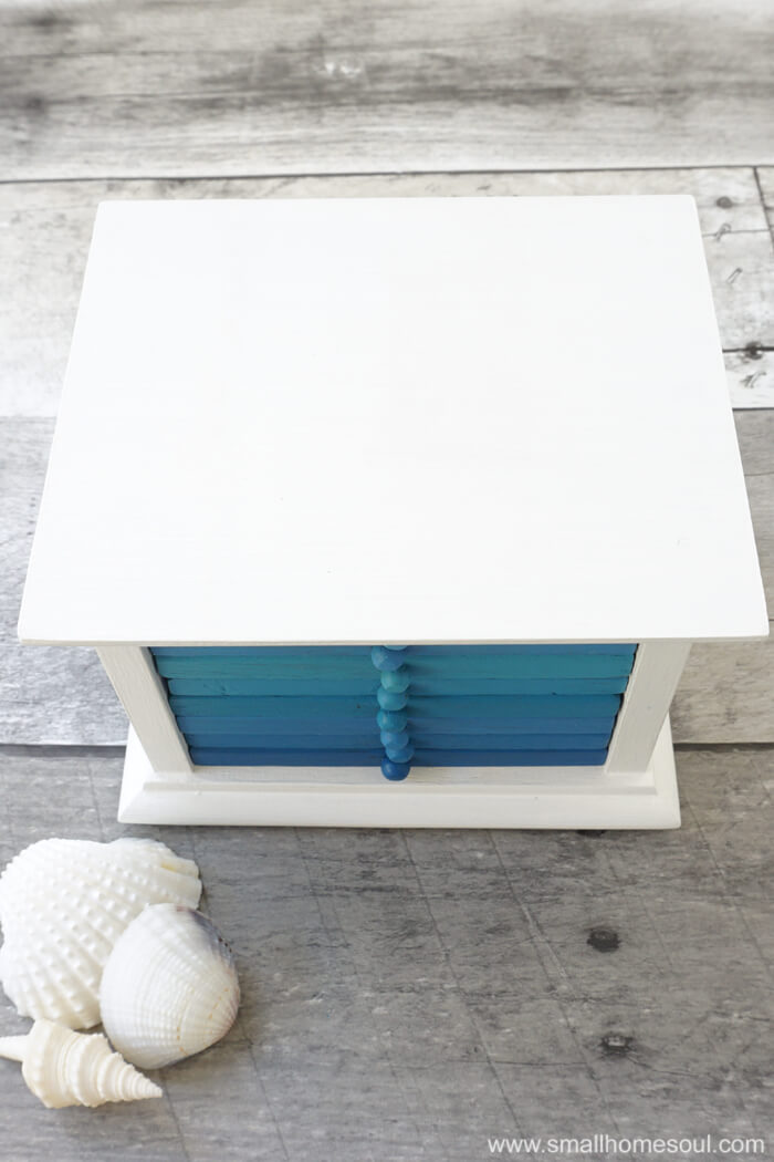 The blues in this coastal drink coaster makeover are perfectly beachy.