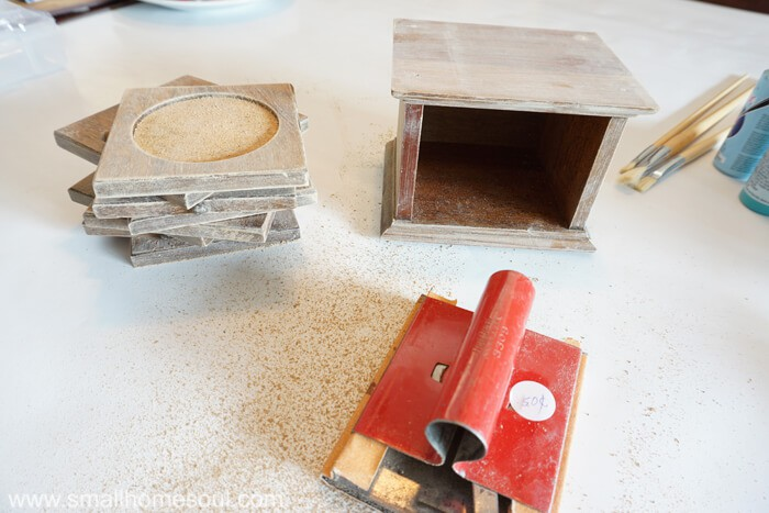 Prepare the drink coaster makeover by lightly sanding all surfaces.