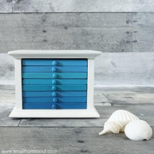 This coastal drink coaster makeover is almost too pretty to use. It will look great in any living room.