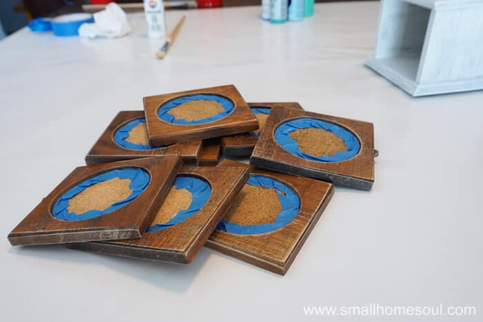 Before painting your drink coaster makeover use painters tape to protect the cork.