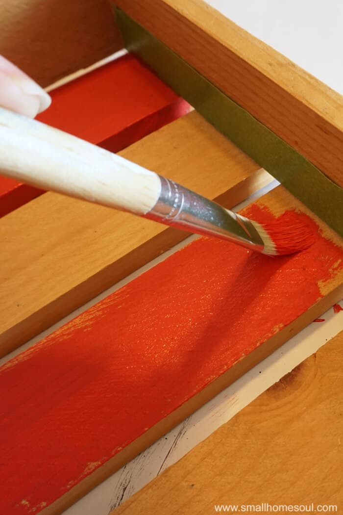 Painting red stripes on July 4th star tray.