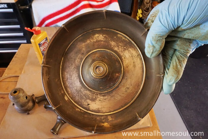 Use brasso to clean the grunge off your brass lamp.