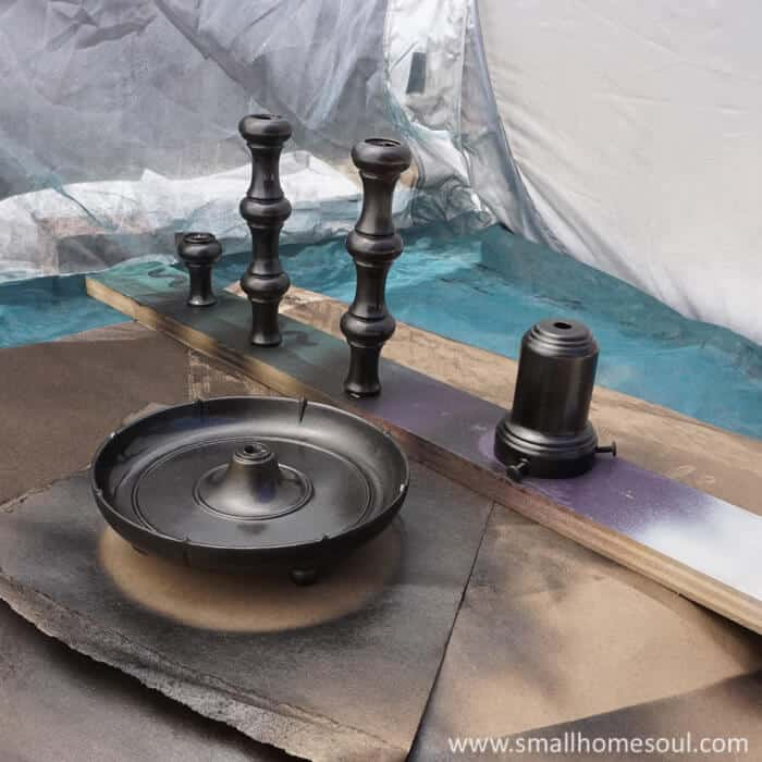 Take apart the brass lamp and spray paint them for the best finish.