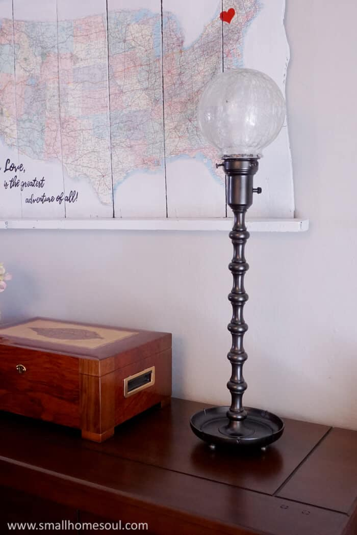 The newly updated brass lamp in metallic black is beautiful in any room.