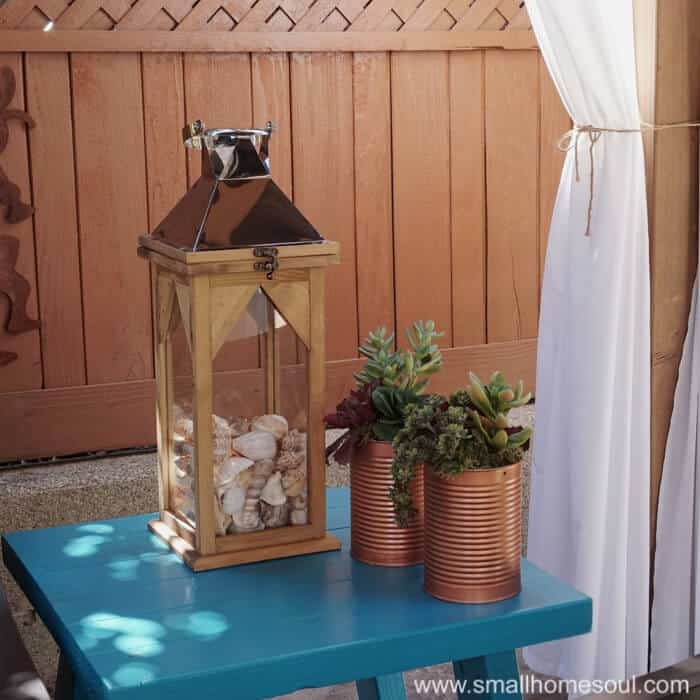 Lanterns aren't just for lighting in your relaxing backyard retreat.
