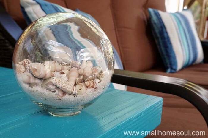 A seashell globe is perfect for a relaxing backyard retreat.