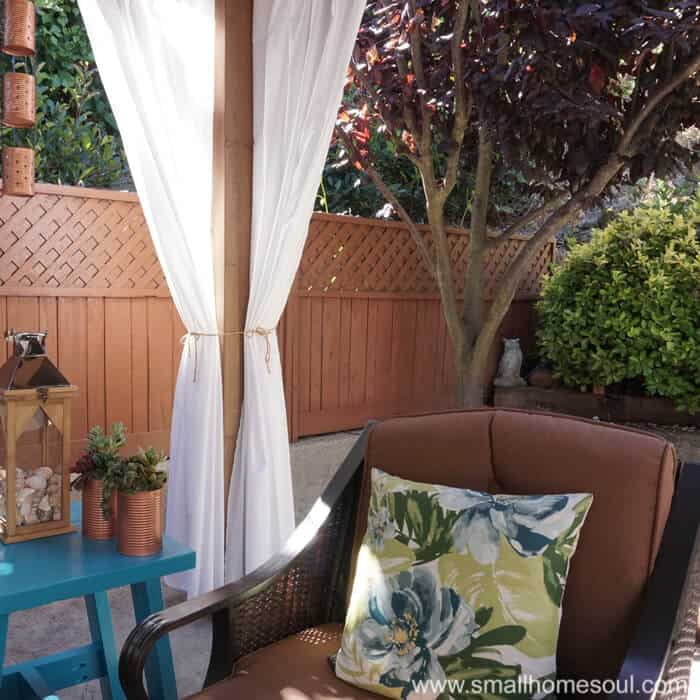 Simple curtains add the perfect touch to a relaxing backyard retreat.