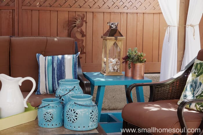 Every relaxing backyard retreat needs a good lantern on the side table.