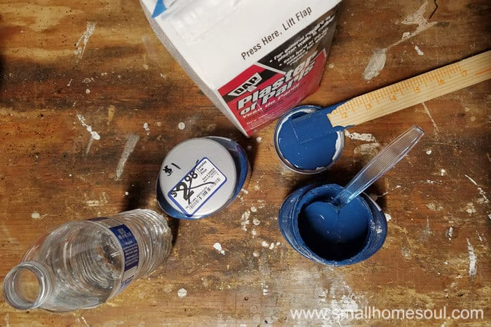 Mixing up chalky paint for the folding stool seat.