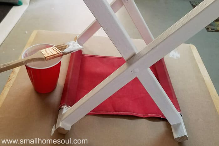 Folding stool gets a new coat of white chalky paint.