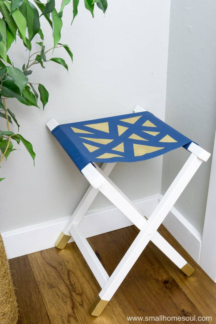 Gold accents on the folding stool seat and feet.