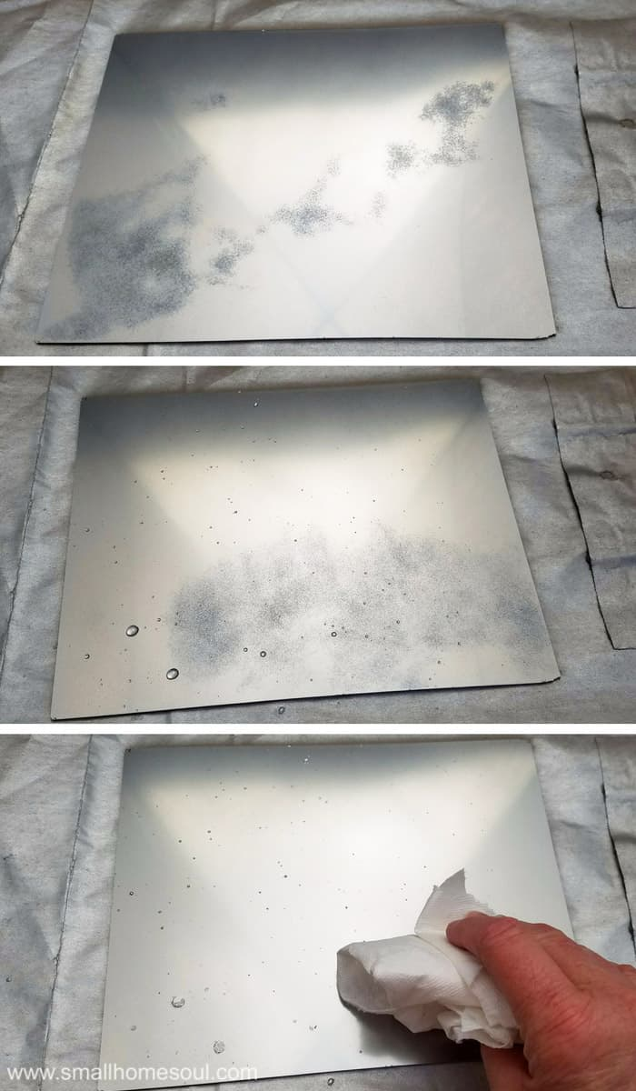 Process of painting with looking glass on a mirrored jewelry tray.