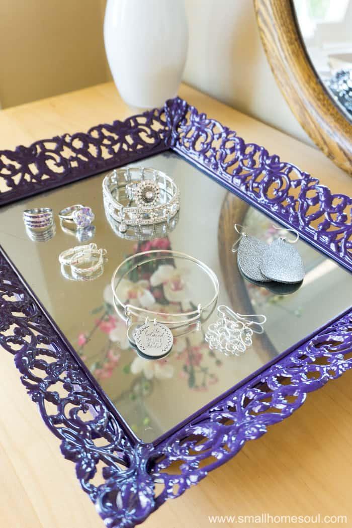 Jewelry tray loaded with shiny jewelry.