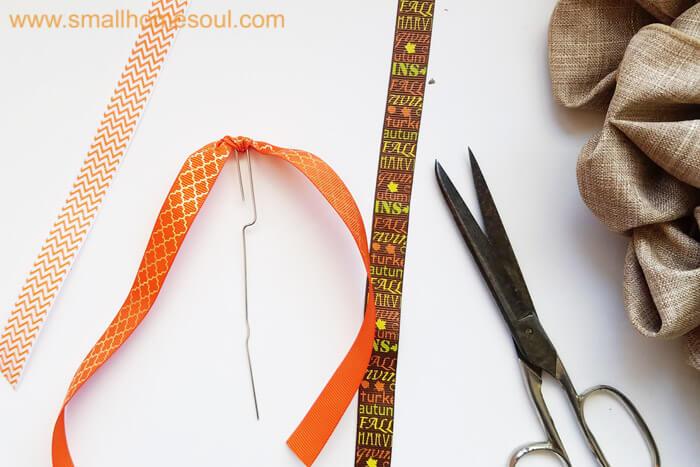 Making a ribbon pick during Fall decor updates. Fall wreath pumpkin wreath.