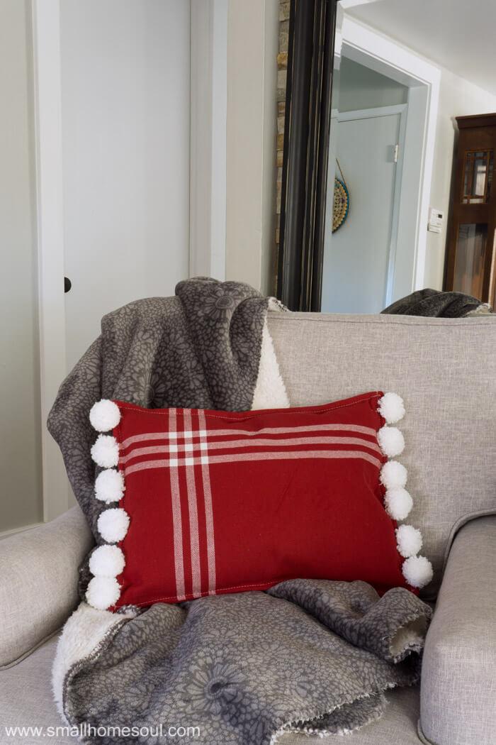 Christmas Pom Pom Pillow with a comfy throw.