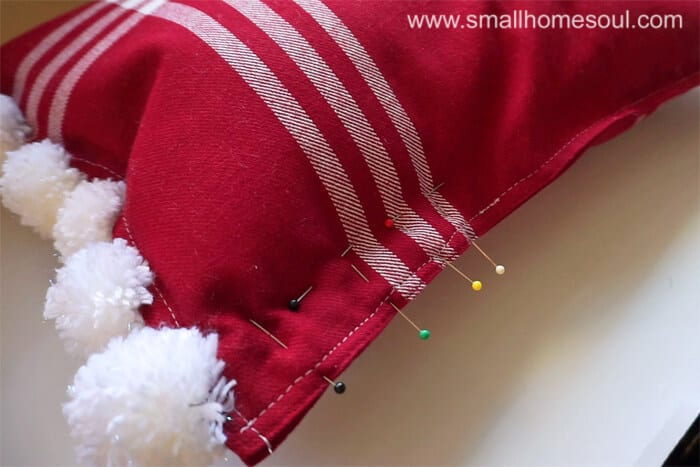Pin & sew edge of Christmas Pom Pom Pillow