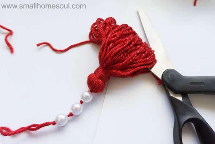 Cutting loop ends on Christmas Tassel Ornament.