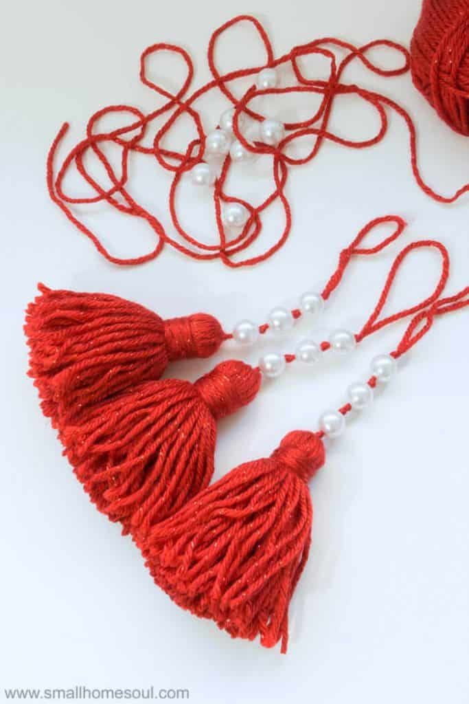 Finished Red Christmas Tassel Ornament with white pearls