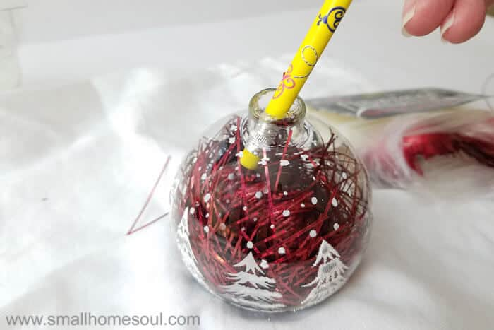 Pencil pushes tinsel for easy ornament updates.