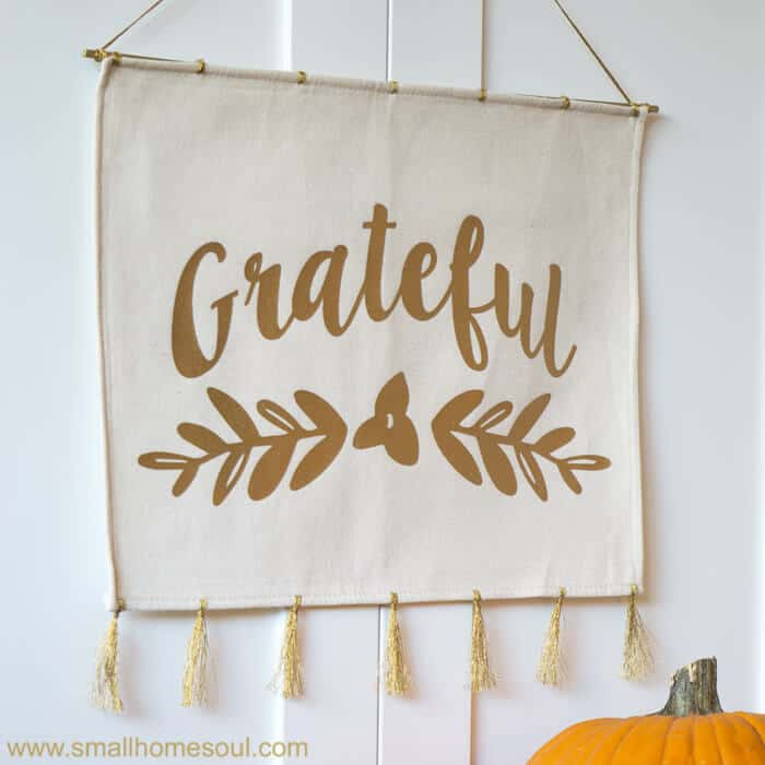 Square grateful wall hanging with pumpkin.