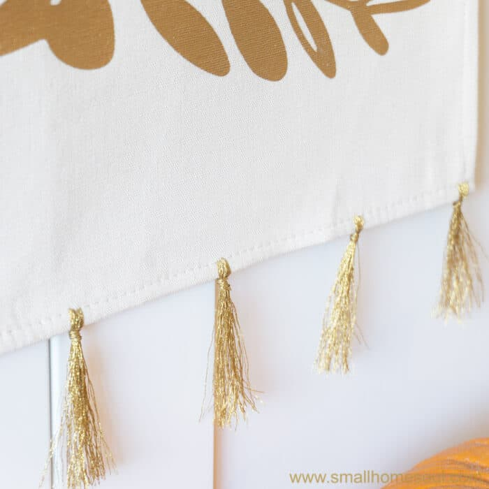 Sun sparkling on the metallic floss of the grateful wall hanging.