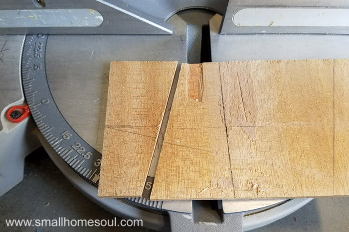 Legs of phone charging stand on the saw.