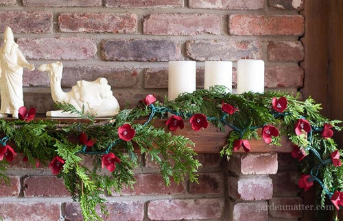 Red Christmas Decor Hearth and Vine red garland.