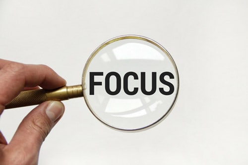 Focus on what's important this year magnifying glass.