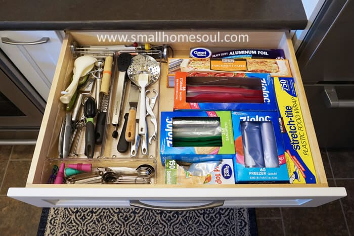 Kitchen utensil drawer after bin organization with plastic bags and aluminum foil