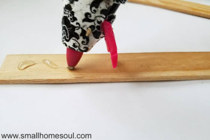 When gluing the photo frame craft support zig zag the bead of hot glue.
