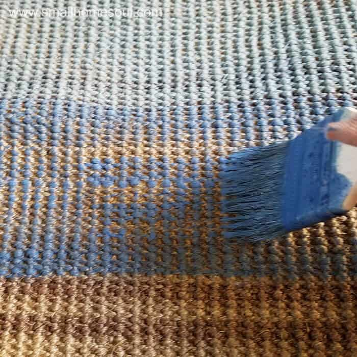To paint a rug apply thinned paint in short strokes.