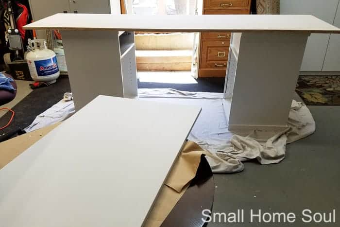 Tops of DIY L Shaped Desk getting painted.
