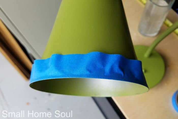 Taping off rim of light cover for desk lamp makeover.