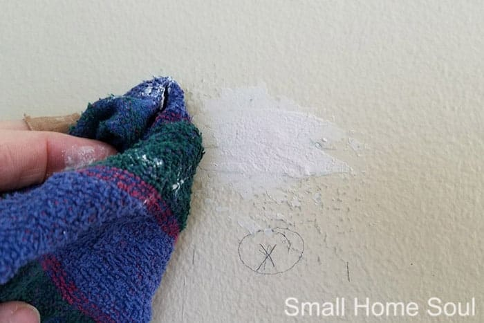 Before you paint a room blend the spackle over holes.