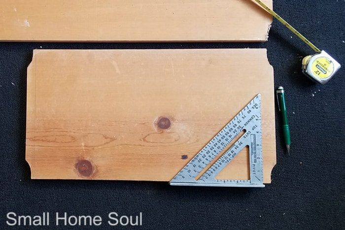 Carpenter's square measuring wood board for cutting to size.box bottom.