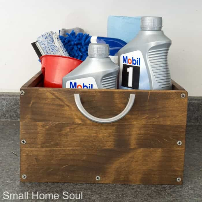 Organized garage with a DIY oil change kit.
