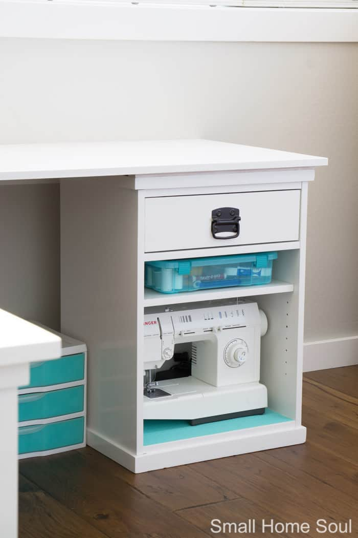 Sewing machine storage in office makeover.