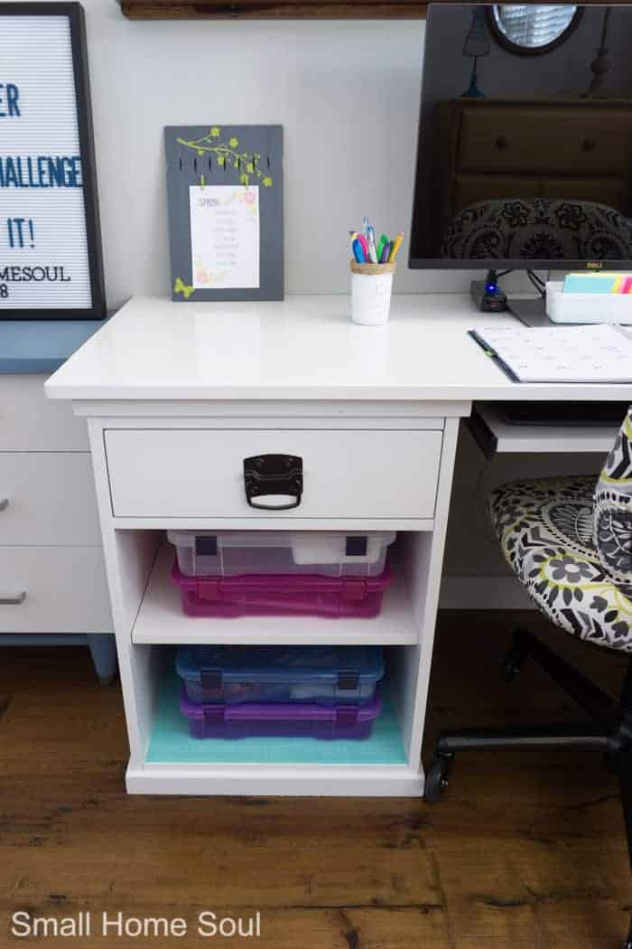 Colorful storage in desk after office makeover.