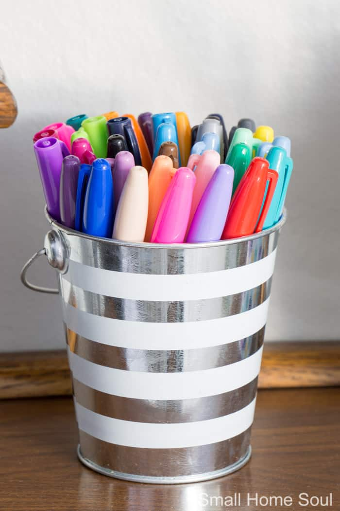 Bucket full of sharpies for office makeover.