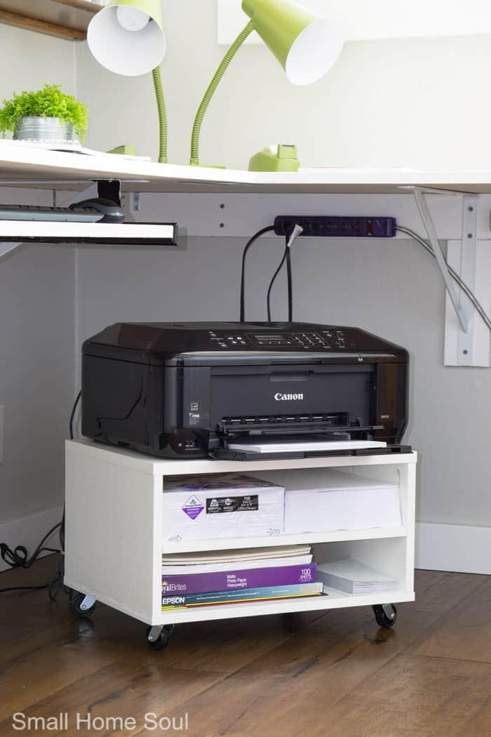 Rolling printer cart in the corner.