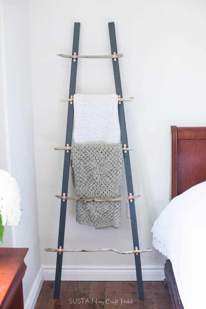 Creative coastal decor in a blanket ladder.