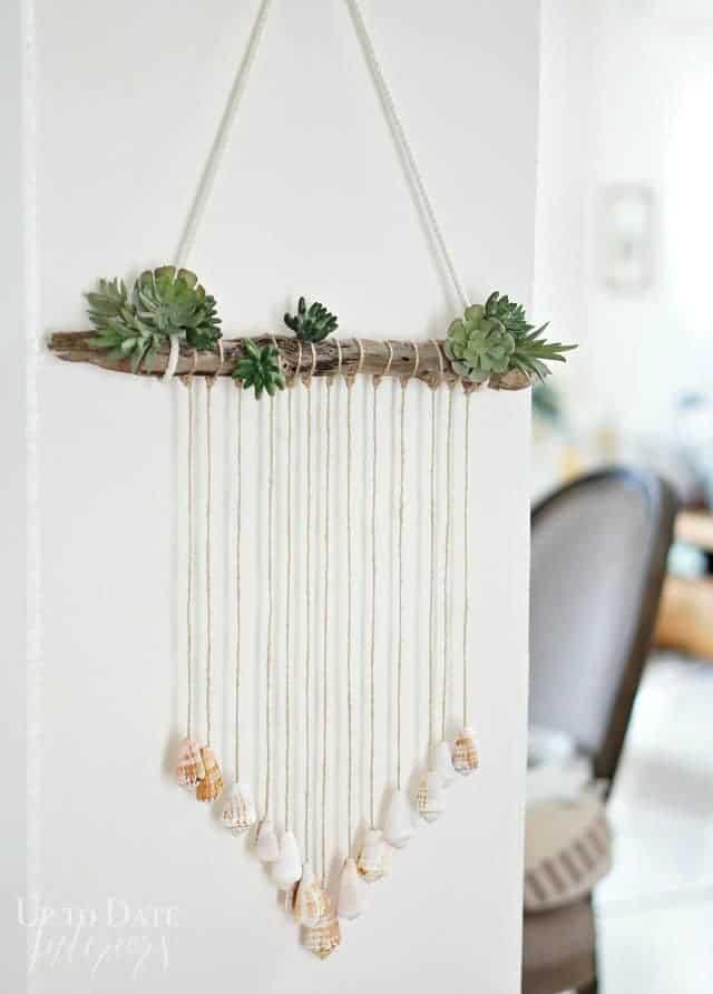 Seashells in creative coastal decor door hanging.