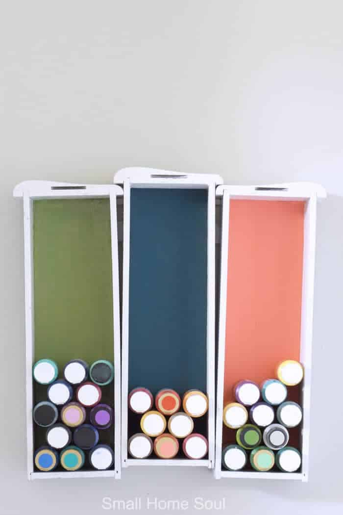 Creative Craft Paint Storage hanging on the wall in the office.